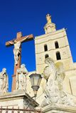 The Popes` Palace in Avignon, France. Crucifix in front of The Popes` Palace in Avignon, France Stock Images