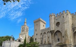 Popes Palace with Blue Sky in Avignon, France. Palace of the Popes, a massive medieval Gothic fortress. UNESCO World Heritage Site in Avignon, France Royalty Free Stock Photo