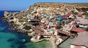 Popeye village, ANCHOR BAY Malta. MALTA - Mart 23, 2015: Famous Popeye village with colorful houses Stock Photo