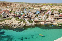 Popeye Village, Malta. Popeye Village near the town of Mellieha, Malta. It was used as the set for Robert Altman's movie 'Popeye' (1980) and is now in use as an Royalty Free Stock Photography