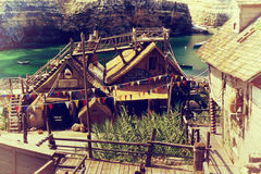 Popeye village, Malta. Malta in August 2001: Village of wooden houses built for the famous movie cartoon Popeye, Malta Island Stock Photography