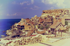 Popeye village, Malta. Malta in August 2001: Village of wooden houses built for the famous movie cartoon Popeye, Malta Island Royalty Free Stock Images