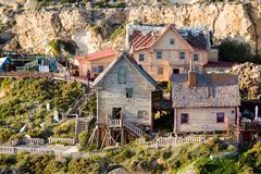 Popeye Village on Malta island. Touristic Popey Village on Malta island. Beautiful citycape and sea in south Europe Royalty Free Stock Images