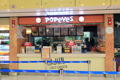 Popeyes restaurant in Hong Kong International airport Stock Photos