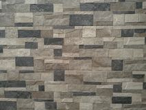 Popielata ceglana kamiennej ściany tekstura, tło zdjęcia royalty free