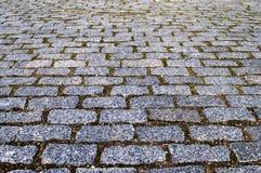 Popielaty brukowych kamieni tło Fotografia Stock