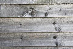 Popielaty drewniany płotowy tło Obraz Stock
