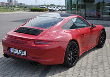 Popiera Czerwony Porsche 911 Carrera 4 GTS Zdjęcia Royalty Free