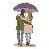 Popiera pary kobiety i mężczyzna odprowadzenie pod parasolem zdjęcia royalty free