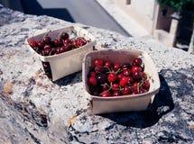 Poplar wood wicker basket with cherries stock images