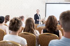 Pople sitting in conference room. Photo of people sitting in stylish conference room Stock Photos