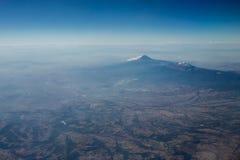 Popocatepetl volcano aerial view. Stock Photos