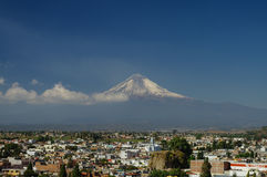 Popocatepetl Volcano Towering over the town of Puebla Stock Photos