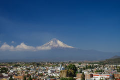 Popocatepetl Volcano Towering over the town of Puebla, Mexico. Puebla, Mexico - January 20, 2010: Popocatepetl Volcano Towering over the town of Puebla Stock Image