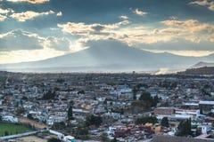 Popocatepetl volcano. A view of Popocatepetl volcano mountain behind Puebla city Royalty Free Stock Images
