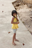 POPOTOTAN ISLAND, BUSUANGA, PHILIPPINES - JANUARY 20,2012 - Girl. Eating ice cream in the Philippine village Royalty Free Stock Photos