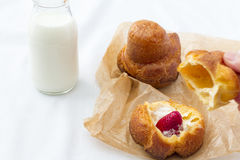 Popover with bottle of milk Royalty Free Stock Photography