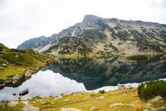 Popovo lake at Bezbog, Bulgaria and mountains reflection Royalty Free Stock Photo