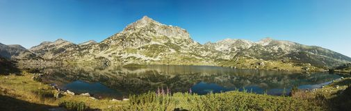 Popovo Lake in Pirin National Park,Bulgaria. Popovo Lake -largest lake in Pirin National Park.Mountains are named after Perun ,highest god of the Slavic pantheon Stock Photos
