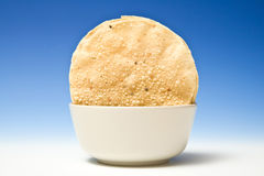 Poppadoms in bowl Stock Photo