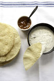 Poppadums with mango chuthey and raita on the table Stock Photography