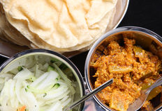 Poppadums and Pickles. Crispy poppadums with lime pickle and onion salad Stock Photography