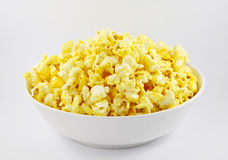 Popped kernels of pop corn snack  on white background. Royalty Free Stock Images