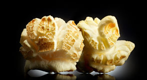 Popped popcorn on a black background Royalty Free Stock Images