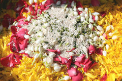 Popped rice and flowers in utensil. Popped rice and flowers in utensil for the worship Royalty Free Stock Photography