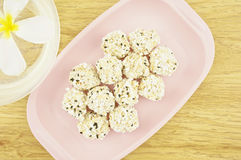 Popped rice mix black sesame on pink tray Stock Photo