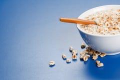 Popped wheat flakes in milk. Healty breakfast - popped wheat flakes with milk in plate Stock Images