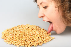 Popped wheat grains and girl Stock Photos