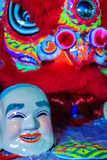 Popper smiling mask and red lion dance costume prepare for Chine Royalty Free Stock Image