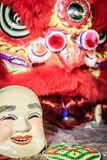 Popper smiling mask and red lion dance costume prepare for Chine Royalty Free Stock Images