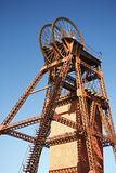 Poppet Head. A headframe, winding tower, poppet head or pit head, is used in shaft mining to support the winding mechanism. The mine shaft is used to gain access Royalty Free Stock Photos