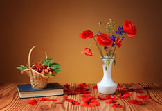 Poppies in a vase, and cherries Stock Photo