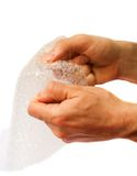 Popping the bubbles. Of bubble wrap Stock Images