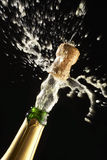 Popping Champagne Cork. Flying off Stock Images