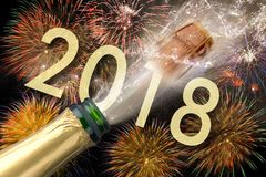 Popping champagne and fireworks at silvester 2018. Popping champagne and fireworks at silvester and new years eve 2018 Stock Images