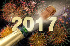 Popping champagne at new years eve 2017. Popping champagne and fireworks at new years eve 2017 Stock Images