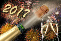 Popping champagne at new years eve 2017. Popping champagne and fireworks at new years eve 2017 Stock Image