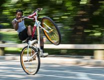 Popping a wheelie in Central Park New York Stock Images