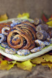 Poppy buns and bagels autumn leaves background Royalty Free Stock Images