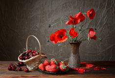 Poppy in a ceramic vase, cherries and strawberries Stock Images