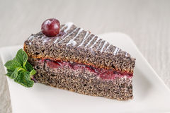 Poppy cream cake with white topping and cherry on top, product photography for patisserie Royalty Free Stock Photos