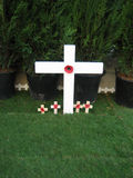 Poppy on cross. Red poppies on white cross on Remembrance Day in London - November 2006 Stock Photography