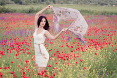 Poppy field and a beautiful girl Stock Images