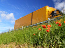 Poppy and motorway Royalty Free Stock Images