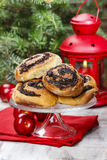 Poppy seed buns on cake stand. Christmas eve setting Stock Photos