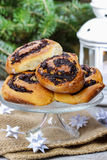 Poppy seed buns on cake stand. Christmas eve setting Royalty Free Stock Photography